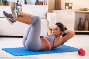 Fitnessgirl macht Sit-Ups Bildquelle: Attractive female exercise at home.Fitness.Doing abs. © SolisImages / Fotolia.com